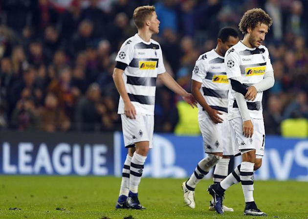 Moenchengladbach's Fabian Johnson, right, leaves the pitch after the Champions League, Group C, soccer match between FC Barcelona and Borussia Moenchengladbach at the Camp Nou stadium in Barcelona