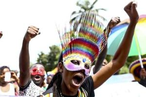People walk in a parade as they celebrate the annulment of an anti-homosexuality law by Uganda's constitutional court in Entebbe