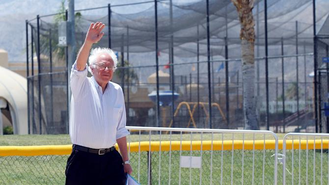 U.S. Democratic presidential candidate Bernie Sanders walks out onto a baseball field to speak at a campaign rally in Cathedral City, California