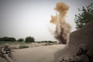 US Marines blowing up a roadside bomb after it was found by a sniffer dog, in Helmand province, in 2010. Five NATO soldiers were killed in three separate attacks in Afghanistan at the weekend, the International Security Assistance Force said Sunday