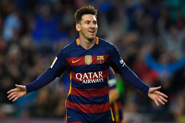 Barcelona's forward Lionel Messi celebrates after scoring a goal during the Spanish league football match FC Barcelona vs Real Sporting de Gijón at the Camp Nou stadium in Barcelona on April 23, 2