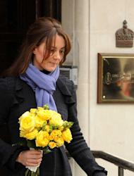 Kate Middleton, pictured here emerging from hospital, is sais to be 'deeply saddened'