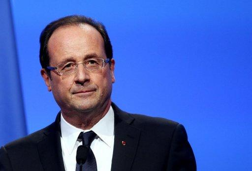 "French President Francois Hollande delivers a speech to the 95th French Mayors congress in Paris. France's main gay lobby has suspended links with the Socialist goverment, saying it felt ""betrayed"" after Hollande appeared to backtrack slightly on plans to legalise gay marriage and adoption."