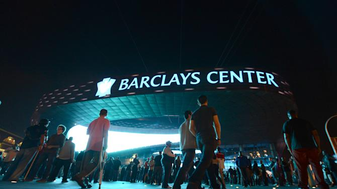 Music fans arrive for the first of eight Jay-Z shows which will open the Barclays Center  in the Brooklyn borough of New York, Friday, Sept. 28, 2012. (AP Photo/Henny Ray Abrams)