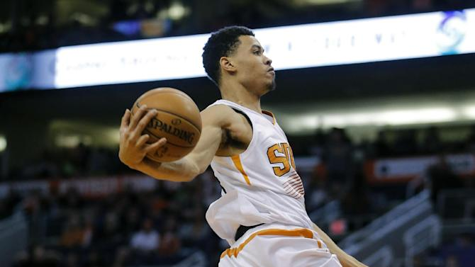 Phoenix Suns' Gerald Green dunks against the Milwaukee Bucks during the second half of an NBA basketball game, Saturday, Jan. 4, 2014, in Phoenix. The Suns won 116-100. (AP Photo/Matt York)