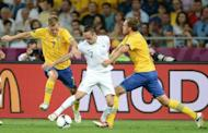 French midfielder Franck Ribery (C is challenged by Sweden's Sebastian Larsson (L) and Andreas Granqvist during their Euro 2012 match on June 19. Sweden were the side that looked to be the one who had a chance of reaching the quarter-finals rather than taking an early flight home