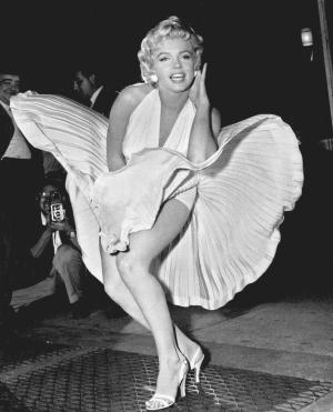 "FILE - In this Sept. 9, 1954 file photo, Marilyn Monroe poses over the updraft of New York subway grating while in character for the filming of ""The Seven Year Itch"" in Manhattan. The former Norma Jean Baker modeled and starred in 28 movies grossing $200 million. Sensual and seductive, but with an air of innocence, Monroe became one of the world's most adored sex symbols. She died alone by suicide, at age 36 in her Hollywood bungalow.  (AP Photo/Matty Zimmerman, File)"