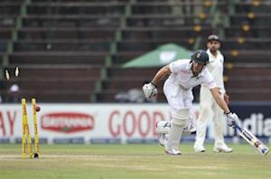 South Africa's Faf du Plessis races to take a run as the wickets are broken in an attempt to run him out during the final day of their test cricket match against India in Johannesburg, December 22, 2013. REUTERS/Ihsaan Haffejee