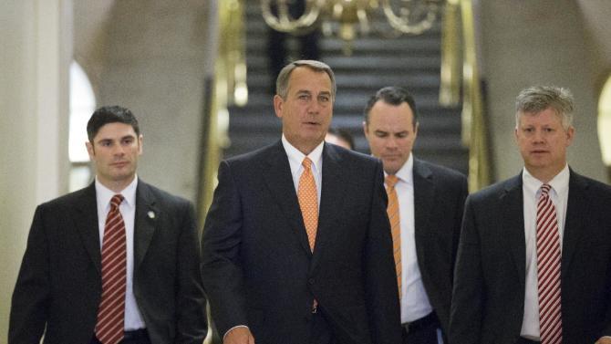 House Speaker John Boehner of Ohio, center, walks to his meeting with President Barack Obama on Capitol Hill in Washington, Wednesday, March 13, 2013.  (AP Photo/J. Scott Applewhite)