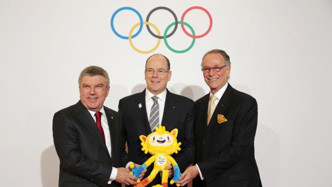 International Olympic Committee (IOC) President Thomas Bach, Prince Albert II of Monaco and Carlos Nuzman, Rio 2016 Games chief, pose with the unnamed mascot of the Rio 2016 Olympic Games before the opening ceremony of the 127th IOC session in Monaco