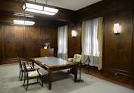 The Tokyo office used by US General Douglas MacArthur, commander of the Allied forces in Japan. The wood-panelled room, with its large windows and translucent curtains, offers a glimpse into history and MacArthur's driven work style: the desk has no drawers so he could not let papers pile up
