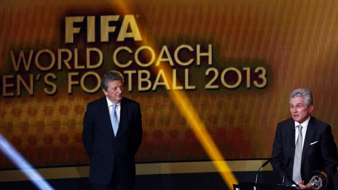 Former Bayern Munich coach Jupp Heynckes speaks after winning the FIFA Coach of the Year award as England manager Roy Hodgson looks on at the FIFA Ballon d'Or soccer awards ceremony in Zurich