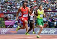 Ryan Bailey of the United States competes in the men's 100m heats at Olympic Stadium in London on Saturday. Bailey ran the fastest ever first-round qualifying time in as the main US and Jamaican favourites all cruised through their heats