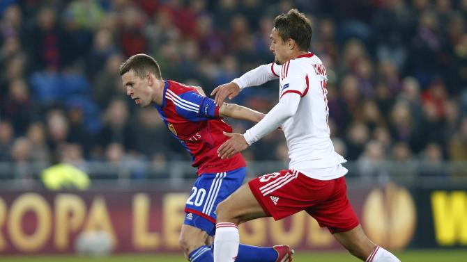 FC Basel's Frei fights for the ball with Ilsanker of FC Salzburg during their Europa League round of 16 soccer match at St.Jakob-Park stadium in Basel