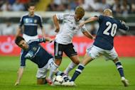 Germany's midfielder Mario Goetze (C), Argentina's Pablo Guinazu (L) and Argentina's Rodrigo Brana vie for the ball during the friendly football match Germany vs Argentina in Frankfurt am Main, western Germany. Argentina won 3-1