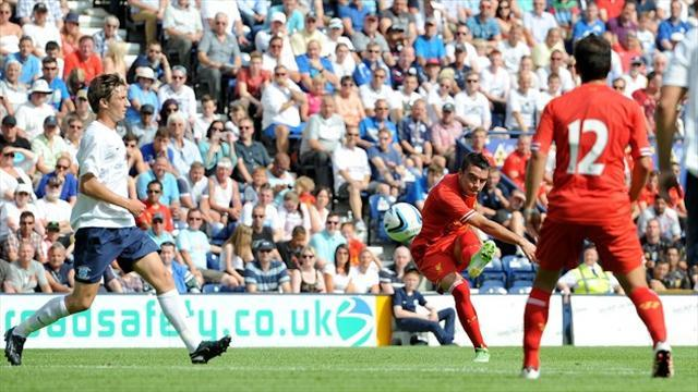 Football - Aspas marks Reds debut with goal