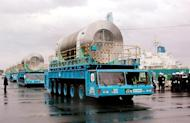 Canisters containing spent nuclear fuel are carried on trailers to the nuclear reprocessing plant at Rokkasho village in Aomori prefecture, 600km north of Tokyo, on December 19, 2000. Japan's only reprocessing plant for spent nuclear fuel could sit on an active seismic fault vulnerable to a massive earthquake, experts warned Wednesday