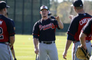 Atlanta Braves pitcher Craig Kimbrel, center, talks with fellow pitcher David Carpenter during a spring training baseball workout on Sunday, Feb. 16, 2014, in Kissimmee, Fla. The Braves agreed to terms with Kimbrel on a four-year contract. (AP Photo/Alex Brandon)