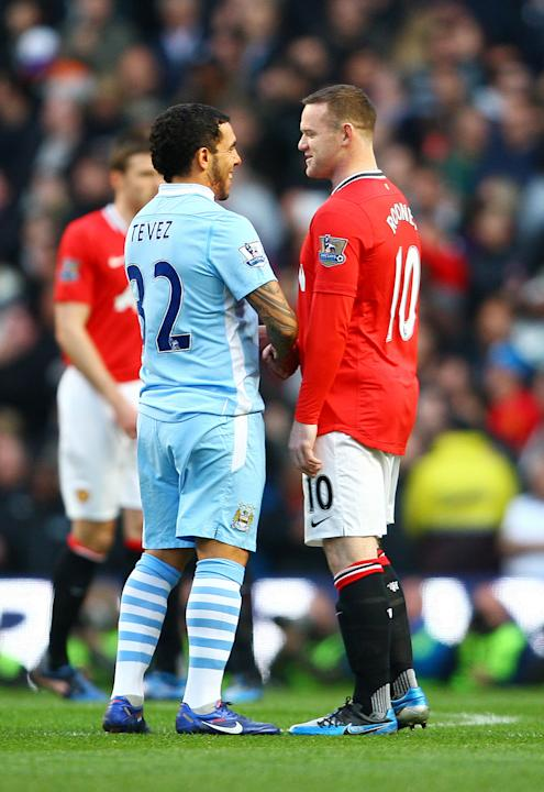 Carlos Tevez de Manchester City y Wayne Rooney de Manchester United.