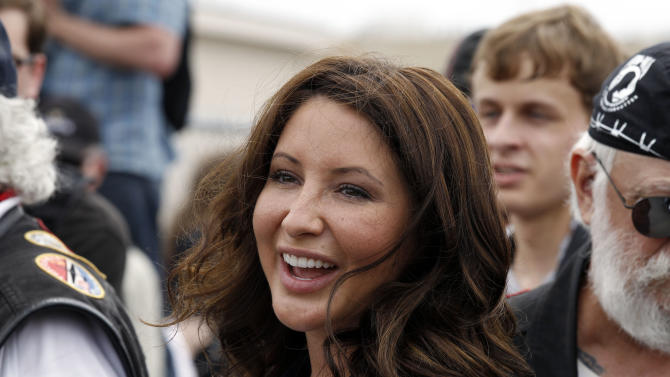 """FILE - In this May 29, 2011 file photo, Bristol Palin, daughter of former GOP vice presidential candidate and Alaska governor Sarah Palin, smiles at the beginning of the Rolling Thunder ride from the Pentagon during the Memorial Day weekend in Washington. Lifetime says it will air 10 episodes of """"Bristol Palin: Life's a Tripp"""" later this year. The series will explore the pressures of raising her toddler son, Tripp, as she maintains her close relationship with the larger Palin clan, the network said. (AP Photo/Alex Brandon, File)"""