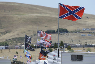 A Confederate-themed flag flies atop an RV at the NASCAR race in June's Sonoma. (AP)