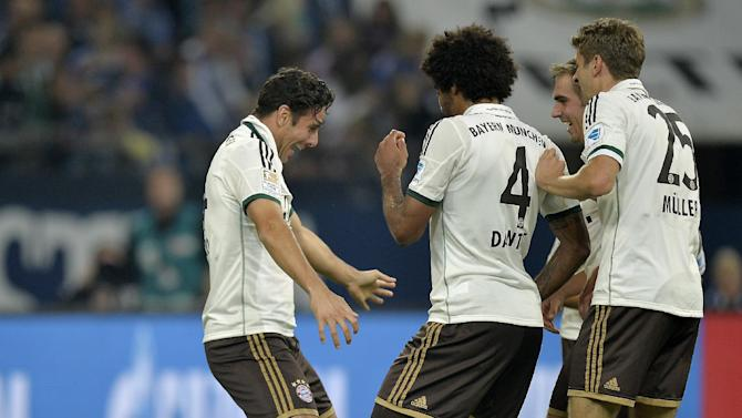 Bayern's Claudio Pizarro of Peru, left, dances with teammates after scoring the 4th goal during the German soccer Bundesliga match between FC Schalke 04 and Bayern Munich at the arena in Gelsenkirchen, Germany, Saturday, Sept. 21, 2013. Schalke was defeated by Bayern with 0-4