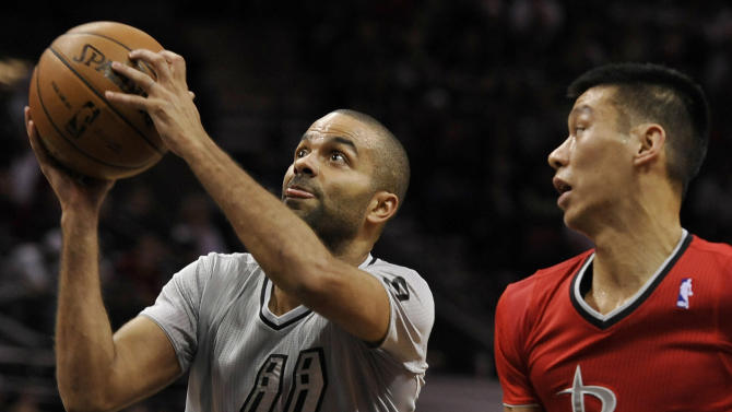 San Antonio Spurs guard Tony Parker, left, of France, shoots sd Houston Rockets guard Jeremy Lin watches during the first half of an NBA basketball game on Wednesday, Dec. 25, 2013, in San Antonio