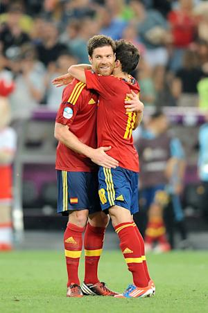 Xabi Alonso (left) was unconcerned by personal milestones as Spain booked their semi-final spot