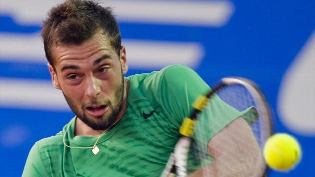 Tennis - Paire beats Simon to reach Montpellier semis