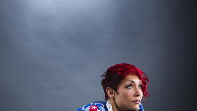 Olympic skeleton racer Uhlaender poses for a portrait during the 2013 U.S. Olympic Team Media Summit in Park City, Utah