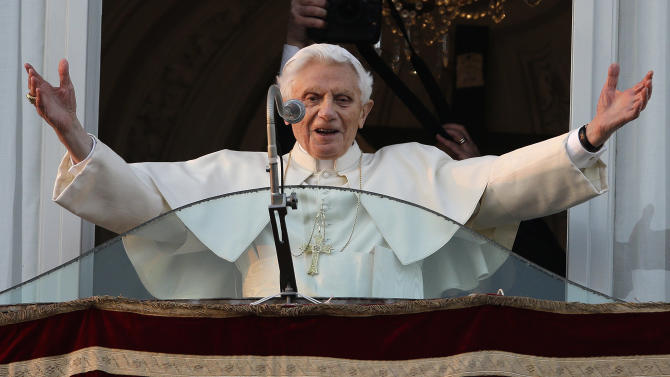 Pope Benedict XVI greets the crowd from the window of the Pope's summer residence of Castel Gandolfo, the scenic town where he will spend his first post-Vatican days and make his last public blessing as pope,Thursday, Feb. 28, 2013. (AP Photo/Andrew Medichini)