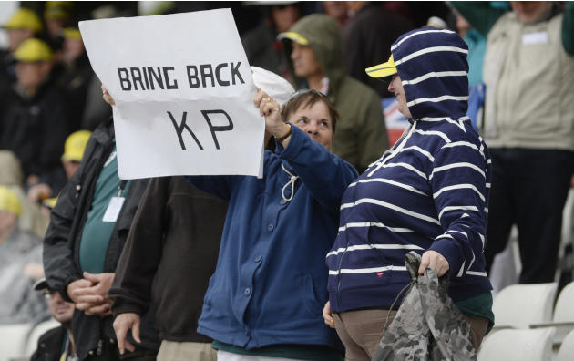 A woman holds up a sign in reference to Kevin Pietersen