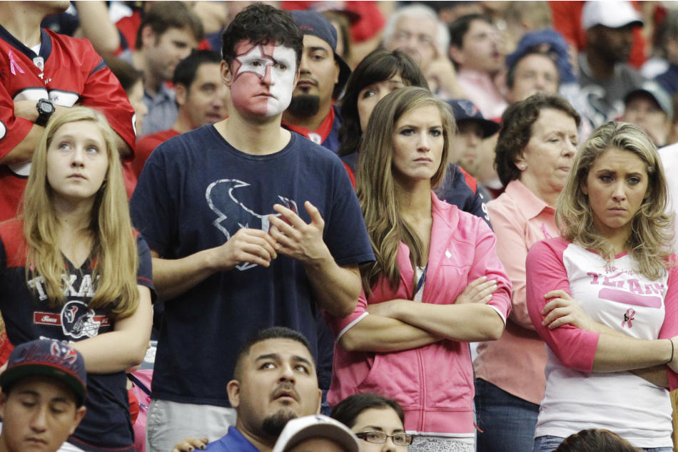 Houston Texans fans watch after quarterback Matt Schaub was injured during the third quarter of an NFL football game against the St. Louis Rams, Sunday, Oct. 13, 2013, in Houston, Texas