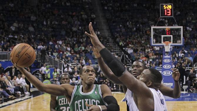Boston Celtics' Rajon Rondo (9) takes a shot over Orlando Magic's Glen Davis during the second half of an NBA basketball game in Orlando, Fla., Sunday, Jan. 19, 2014. Orlando won 93-91