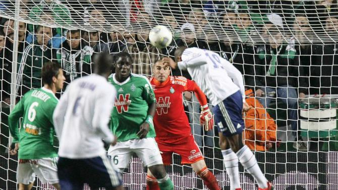 Briand of Olympique Lyon heads to score against St Etienne during their French Ligue 1 soccer match at the Geoffroy Guichard stadium
