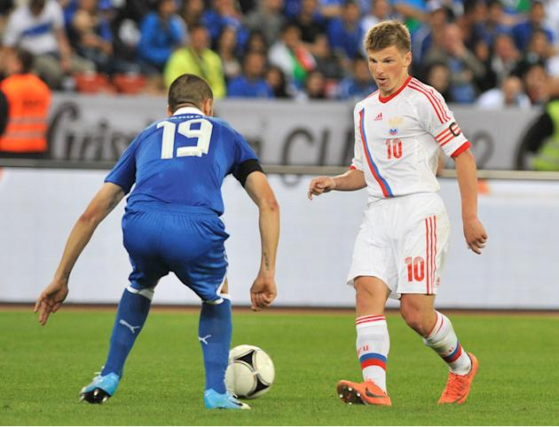 Italy's Bonucci (L) Vies For The Ball With Russian's Arshavin  SEBASTIEN FEVAL/AFP/GettyImages AFP/Getty Images
