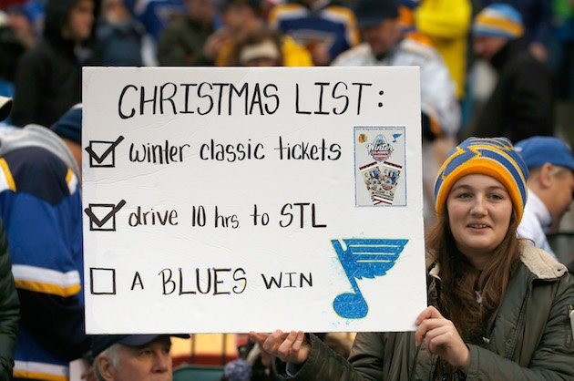ST LOUIS, MO - JANUARY 02: A fan holds a sign in the stands during the 2017 Bridgestone NHL Winter Classic between the St. Louis Blues and the Chicago Blackhawks at Busch Stadium on January 2, 2017 in St Louis, Missouri. (Photo by Eliot J. Schechter/NHLI via Getty Images)