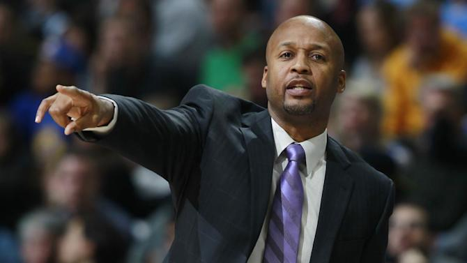 Denver Nuggets head coach Brian Shaw directs his team against the Golden State Warriors in the first quarter of an NBA basketball game in Denver, Monday, Dec. 23, 2013