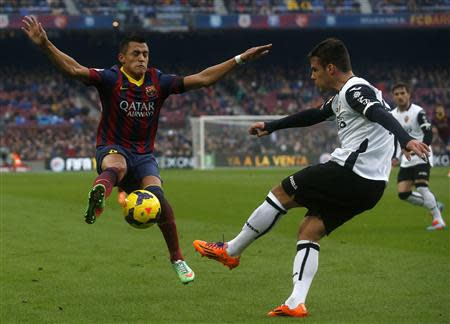 Barcelona's Alexis Sanchez fights for the ball against Valencia's Juan Bernat during their Spanish first division soccer match at Camp Nou stadium in Barcelona