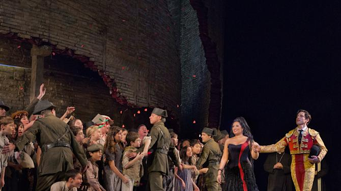 """In this Sept. 22, 2012 photo provided by the Metropolitan Opera, Kyle Ketelsen, right, performs in the role of Escamillo with Anita Rachvelishvili as the title character in Bizet's """"Carmen,"""" during a rehearsal at the Metropolitan Opera in New York. (AP Photo/Metropolitan Opera, Ken Howard)"""