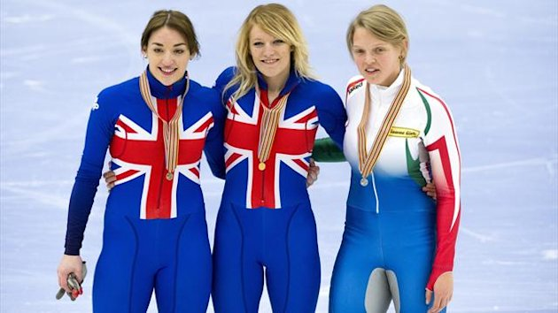 SWEDEN, Malmö : Great Britain's Elise Christie (C) poses with Italy's Arianna Fontana (R) and GB's Charlotte Gilmartin after the ladies' 1500m final