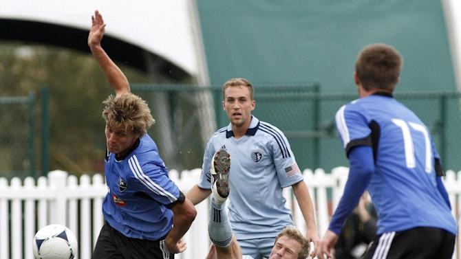 Sporting Kansas City forward Jacob Peterson, center, takes an inverted kick past Montreal Impact's Aaron Schoenfeild, left, and Justin Braun, right, while Sporting Kansas City' Kyle Miller looks on during a soccer match at the Walt Disney World Pro Soccer Classic, Sunday, Feb. 26, 2012, in Lake Buena Vista, Fla