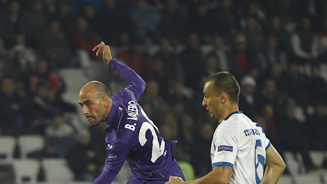 Fiorentina's Borja Valero shoots to score in the dying moments of an Europa League, group E match, between Fiorentina and Pandurii, at the Cluj Arena stadium in Cluj, Romania, Thursday, Nov. 7,  2013