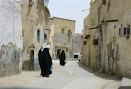Veiled women walk along a street at the neighbourhood of Shmeisy in Riyadh April 22, 2013. REUTERS/Faisal Al Nasser/Files