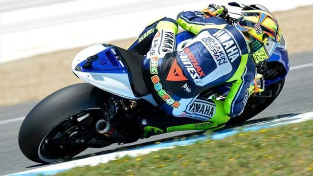 Motorcycling - Rossi takes charge in second session