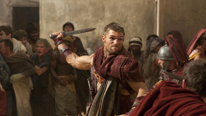 """In this undated file image originally released by Starz, Liam McIntyre portrays the title role in a scene from """"Spartacus: Vengeance,"""" airing on Starz. Starz network says it is ending its highly successful """"Spartacus"""" saga next season. In an unusual move announced Monday, Starz will conclude this action-adventure series while it's still a big hit, and after logging only three seasons (or four, counting a """"prequel"""" season). This season the series drew six million viewers, an enormous number for a paid subscription channel. (AP Photo/Starz Entertainment)"""