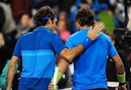 Roger Federer (left) and Rafael Nadal walk off the court after Federer defeated Nadal in the final of the BNP Paribas Open in Indian Wells, California., in March. Federer won a 17th Grand Slam title this summer with a seventh Wimbledon to match the mark of Pete Sampras
