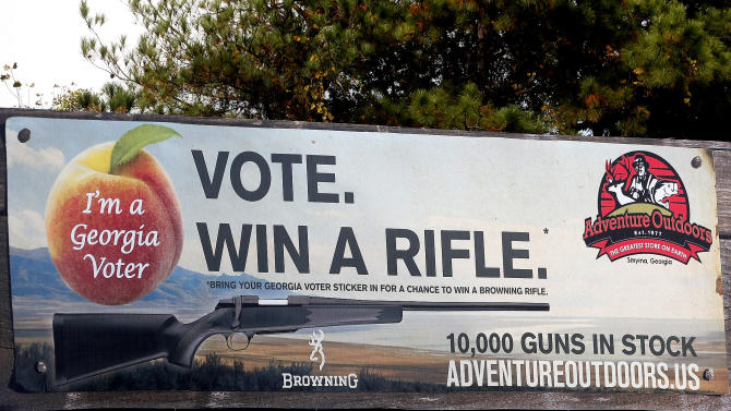 One of several billboards of a gun raffle promotion at Adventures Outdoors in Smyrna.