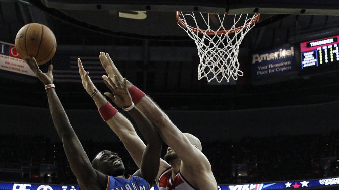 Oklahoma City Thunder guard Reggie Jackson (15) shoots over Washington Wizards center Marcin Gortat (4), from Poland, in the first half of an NBA basketball game on Saturday, Feb. 1, 2014, in Washington. (AP Photo/Alex Brandon)