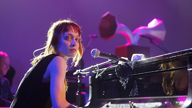 FILE - This March 14, 2012 file photo shows Fiona Apple performing at the NPR showcase during the SXSW Music Festival in Austin, Texas. Fiona Apple is postponing her South American tour to be with her dying dog, Janet, according to her heartfelt, handwritten letter to fans posted on her website and Facebook page on Tuesday, Nov. 20, 2012. (AP Photo/Jack Plunkett, file)